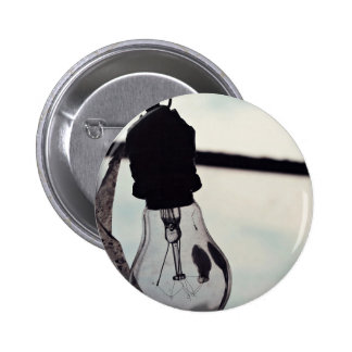 Wire Themed, A Closed Blub Is Hanging With Its Own Pinback Button