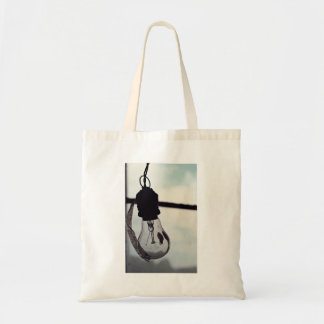 Wire Themed, A Closed Blub Is Hanging With Its Own Tote Bag