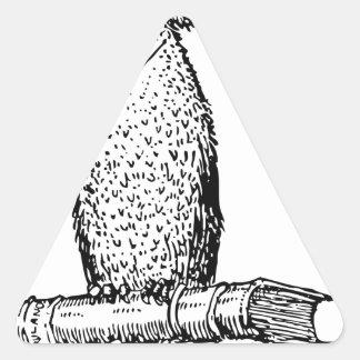 wise owl on books. triangle sticker
