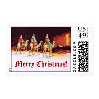 Wisemen que viaja en el Camelback Felices Navidad