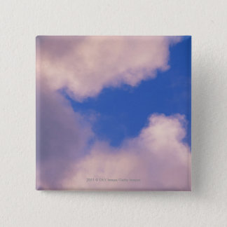 Wispy clouds against blue sky pinback button
