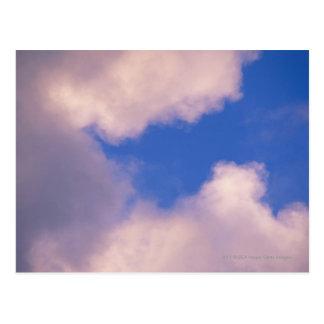 Wispy clouds against blue sky postcard
