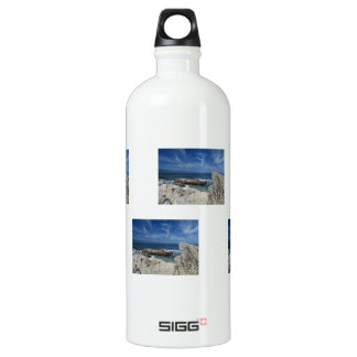Wispy Clouds Over The Rocks Water Bottle