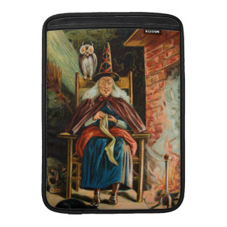 Witch at Fireplace MacBook Sleeves