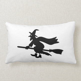 Witch with the broom flies throw pillows