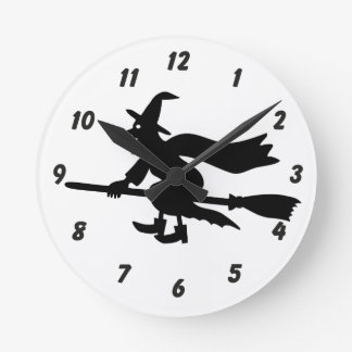 Witch with the broom flies round clock