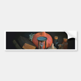 Witchery objects on a table in a dark room bumper sticker