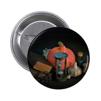 Witchery objects on a table in a dark room pinback button