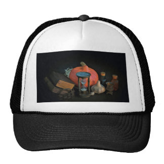 Witchery objects on a table in a dark room trucker hat