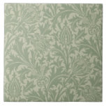 """Wm Morris Arts &amp; Crafts Green Thistle Repro Tile<br><div class=""""desc"""">William Morris (1834-1896) was a prolific English textile designer,  artist,  writer,  illustrator,  medievalist and socialist. He believed good design should be available to everyone. The Studio also produced a Thistle design by Dearle,  but this is the authentic William Morris design.</div>"""