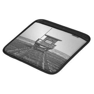 Wodden cabin on a beach iPad sleeves