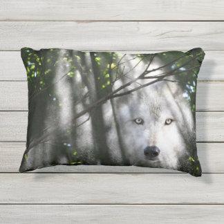 Wolf face in a sunbeam outdoor pillow