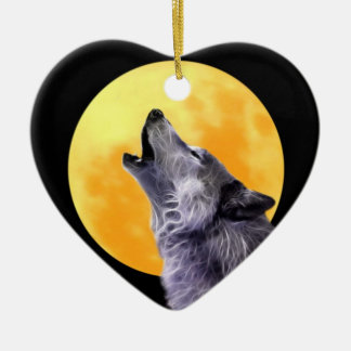 Wolf howls at the full moon ceramic ornament