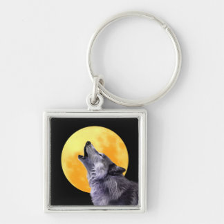 Wolf howls at the full moon keychain
