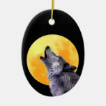 Wolf howls at the full moon ornament