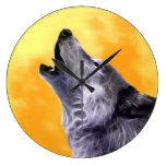 Wolf howls at the full moon wall clocks