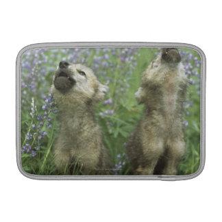 Wolf Puppies Howling In Meadow MacBook Air Sleeves