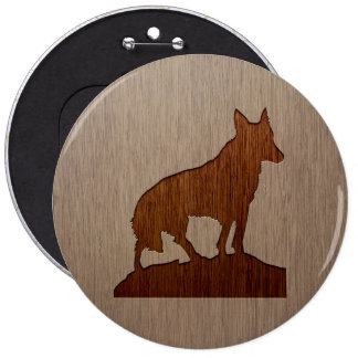 Wolf silhouette engraved on wood design button