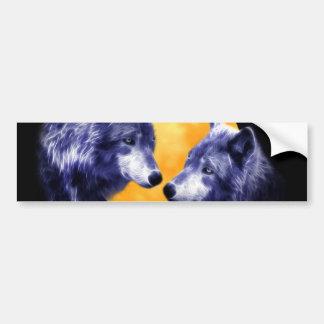 Wolves at full moon car bumper sticker