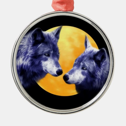 Wolves at full moon round metal christmas ornament