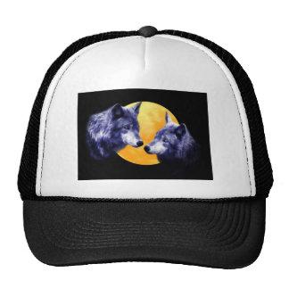 Wolves at full moon trucker hat