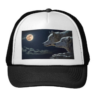 Wolves at night trucker hat