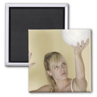 Woman about to serve volleyball magnet