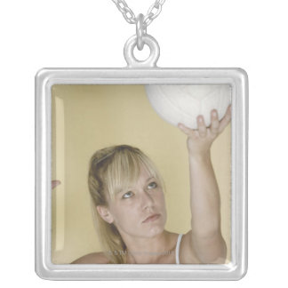 Woman about to serve volleyball silver plated necklace