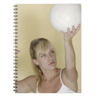 Woman about to serve volleyball spiral notebook