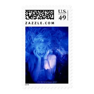 Woman afraid postage stamp