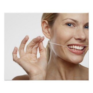 Woman against white background flossing teeth, poster