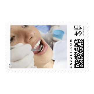 Woman, aged 27, being examined in a dentists postage stamps