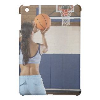 Woman aiming at hoop with basketball, rear view iPad mini case