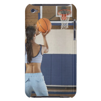 Woman aiming at hoop with basketball, rear view iPod touch cover