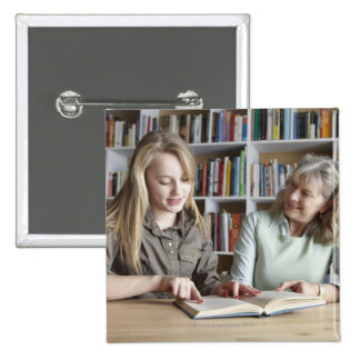 Woman and granddaughter reading together button
