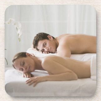 woman and man lying on massage benches drink coaster
