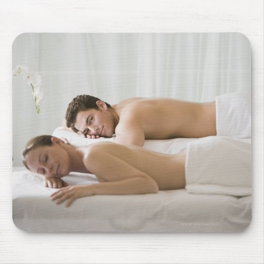 woman and man lying on massage benches mouse pad