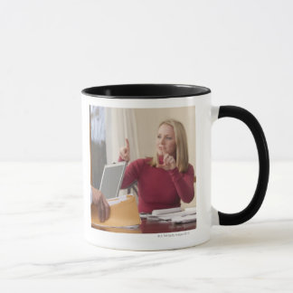 Woman and man signing the word 'Envelope' in Mug