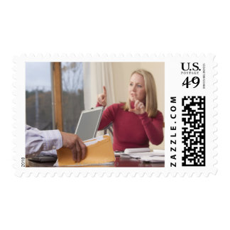 Woman and man signing the word 'Envelope' in Stamp