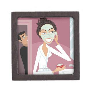 Woman applying facial mask gift box