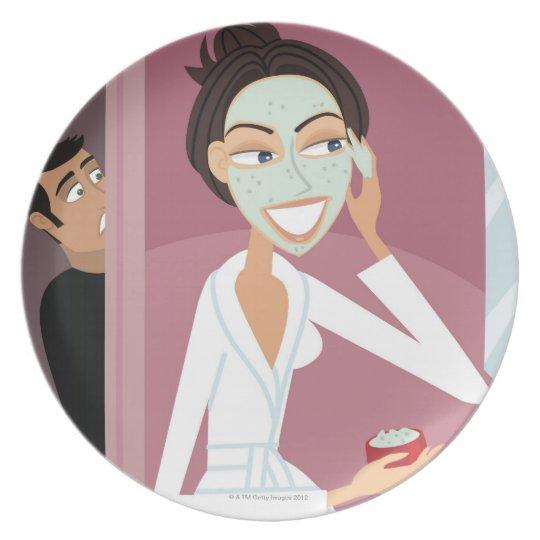 Woman applying facial mask plate