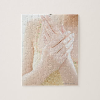 Woman Applying Hand Care Cream Jigsaw Puzzle