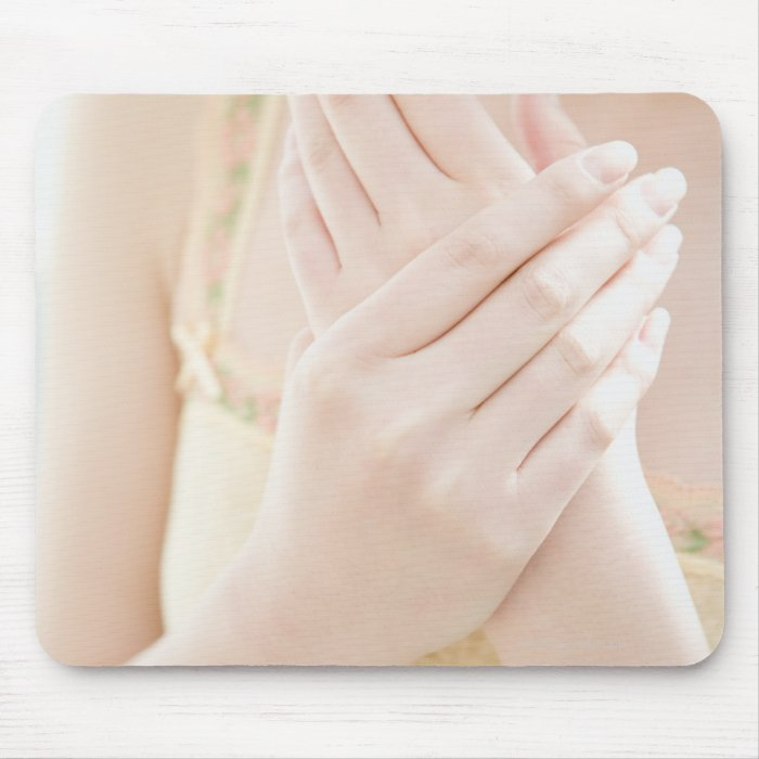 Woman Applying Hand Care Cream Mouse Pad