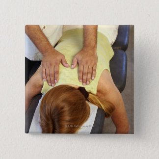 Woman at chiropractic appointment button