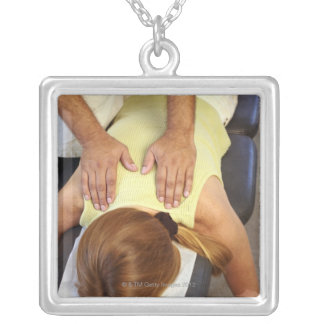Woman at chiropractic appointment square pendant necklace