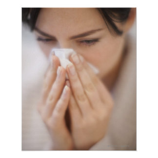 Woman blowing her nose. poster