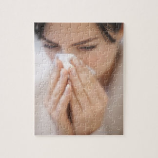 Woman blowing her nose. jigsaw puzzles