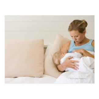 Woman breastfeeding baby postcard
