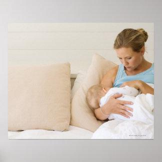 Woman breastfeeding baby poster