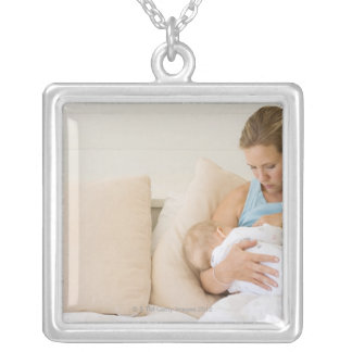 Woman breastfeeding baby silver plated necklace